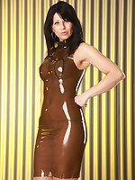 Sexy Desyra Noir posing in a brown plastic dress | DesyraNoir.com