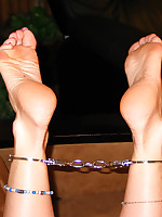 Nikki's sexy barefeet cuffed at the ankles